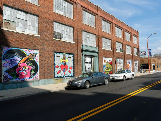 """Numerous works that are part of """"small spaces: Lafayette"""" grace the Haywood Printing building."""