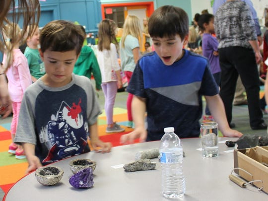 Glen Ridge's Forest Avenue School kindergartners Ryan Hartenberger, left, and Sam Sperling examine rocks and minerals during an enrichment program organized by the Forest Avenue Home and School Association on Wednesday, May 31, 2017.