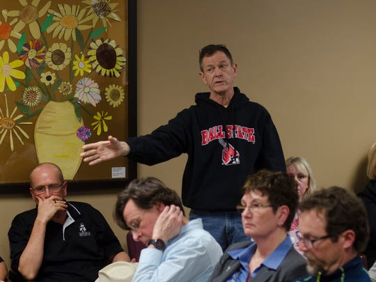 Winchester resident Dave Daly speaks in opposition to the location of a proposed drug treatment facility in his neighborhood during the city's common council meeting Monday, Feb. 20, 2017.