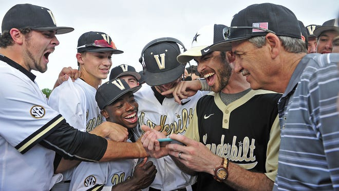 Vanderbilt's Dansby Swanson, center, in headphones, is congratulated after learning he was the No. 1 pick in the MLB Draft.
