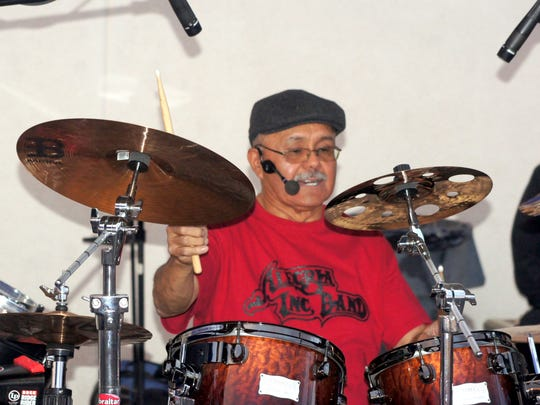 Alegria band leader Ernest Holguin keeps the beat during the free concert at Peppers Supermarket. The band was asked to play for the store's 20th anniversary on Friday, July 15, 2016.