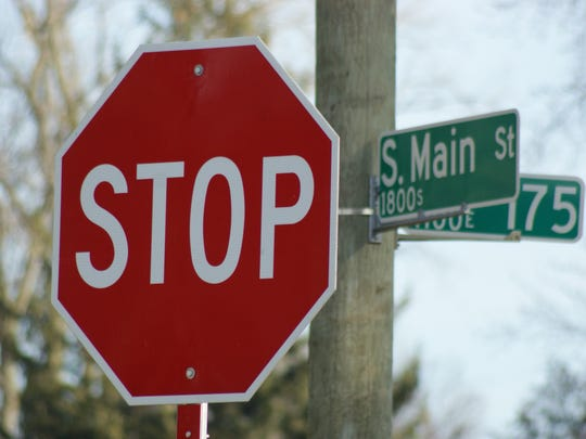 Stops signs at the intersection of Ohio 101 and County