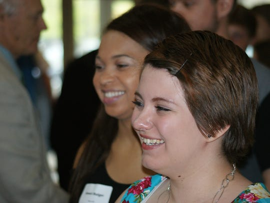 Summer Wagner, near, and Amari Bulger, far, are greeted by guests at the Sandusky County Positive People Awards held at the Neeley Center at Terra State Community College.