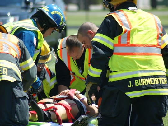 A passenger, played by Morgan Hawk, is taken by Life Flight to Toledo as part of a mock crash at Ross High School.