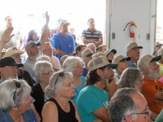 An overflow crowd of 80 people attended Wednesday's Friends of Rockhound State Park meeting to hear David Tognoni of Elephant Butte talk about a proposed dolomite mining project in the Florida Mountains.