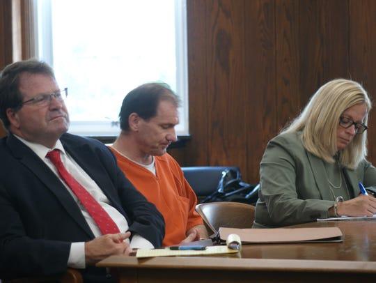 Toledo attorneys Merle Dech and Jane Roman flank Daniel