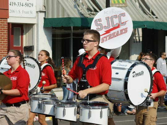 St. Joseph Central Catholic Marching Band plays along Front Street during the Labor Day parade.