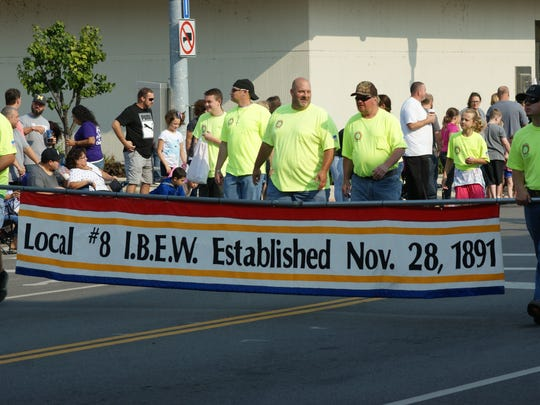 International Brotherhood of Electrical Workers Local 8 leads parade of union groups during Labor Day festivities in Fremont.