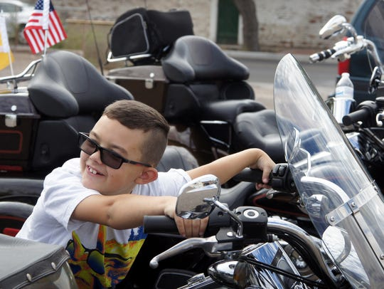 Landin Dupree, 8, is ready to pull out with his parents,