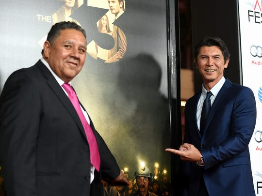 "HOLLYWOOD, CA - NOVEMBER 09:  Chilean miner Luis Urzua (L) and actor Lou Diamond Phillips attend the Centerpiece Gala Premiere of Alcon Entertainment's ""The 33"" during AFI FEST 2015 presented by Audi at TCL Chinese Theatre on November 9, 2015 in Hollywood, California.  (Photo by Kevin Winter/Getty Images For AFI)"