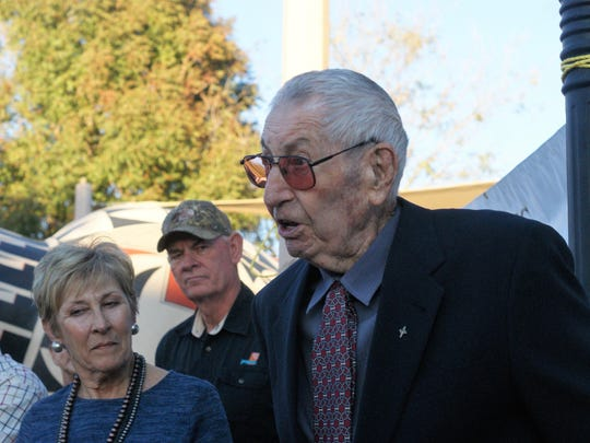 Claude Leyendecker, 95, rose to speak following a tribute by Deming Mayor Benny Jasso at a ceremony re-dedicating the downtown plaza named in his honor. Also pictured, from left, are Claudia Jeffreys (his daufhter), and Dale Stevens of Deming.