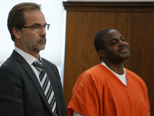 Drug kingpin Keith Nettles, with attorney David Klucas of Toledo, smirks as he is sentenced to 34 years in prison by Sandusky County Common Pleas Court Judge Robert Hart.