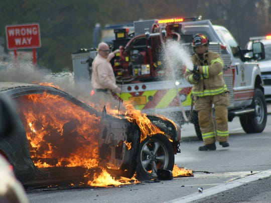 A vehicle caught fire Thursday morning after a crash,