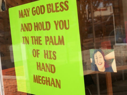 The display windows at the Deming Dust Devils gymnasium in downtown Deming quickly filled up with photographs and home-made signs mourning the sudden illness and passing of Meghan Flores.