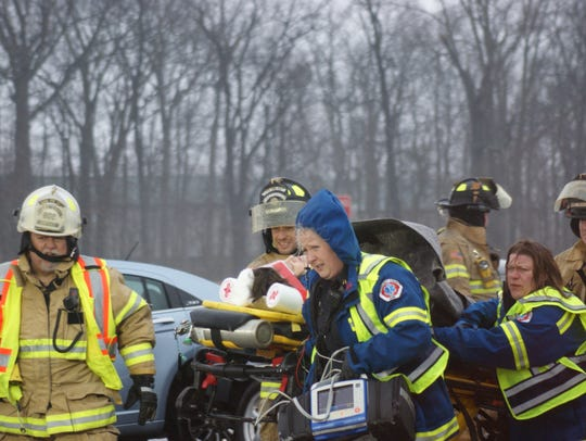 A woman is taken by Sandusky County EMS from a crash