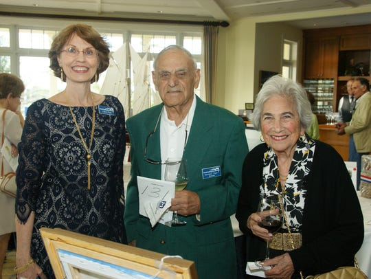"Chris Pope, left, with Varoujan ""Pops"" and Rose Karentz"