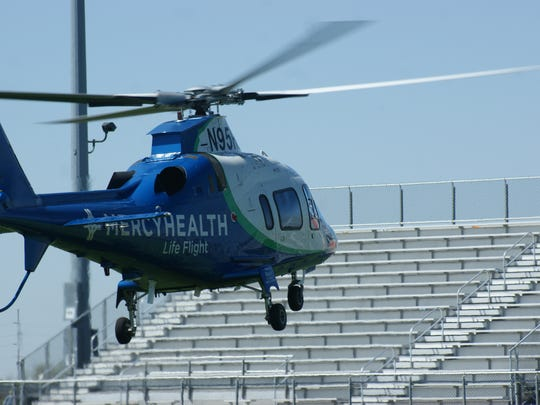 A Mercy Life Flight helicopter takes off from Gibsonburg
