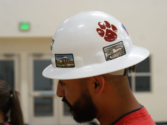 The Wildcat pawprint on a hardhat designates workers