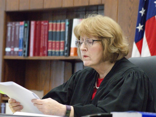 Visiting judge Patricia Cosgrove listens to attorneys