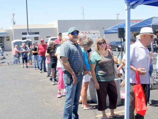 Customers waited in line for the Hereford Beef rib-eye