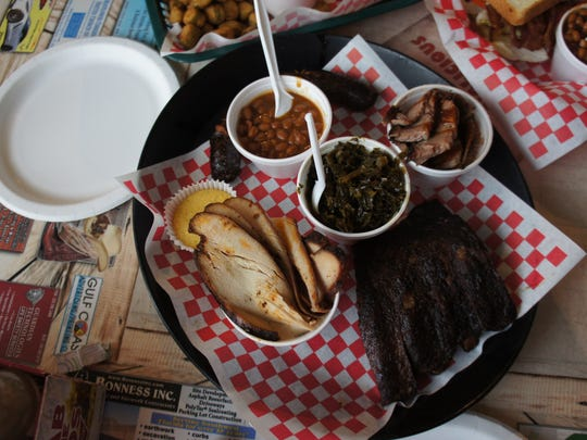 The Black Eyed Sampler from Black Eyed Pig BBQ includes a choice of four meats, two side dishes and either a jalapeño corn muffin or Texas toast.