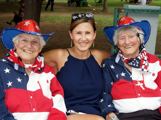 Susie Mendez, center, spent some time with Fourth of July celebration fixtures Gertrude, right, and Geraldine Kretek at last year's celebration.
