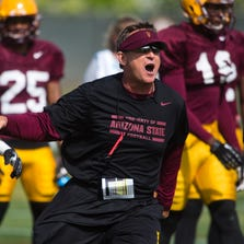 Arizona State University defensive coordinator Keith Patterson yells during practice at ASU, Tuesday, April 15, 2014.