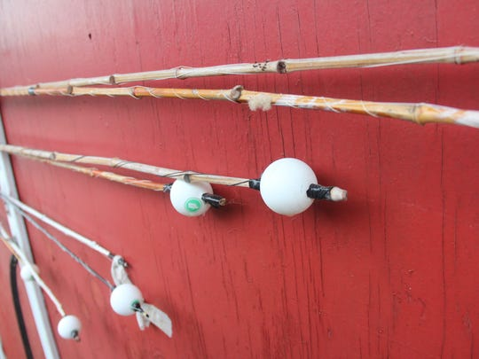 Cane poles hang on the back of a Wolf River fishing