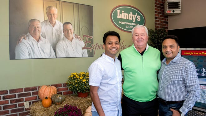 Former Lindy's Downtown Market owner Jim Linsley, middle, poses with new owners Neel Patel, left, and Chris Patel at the store at 110 Peoria Street in Washington. The small grocery store has been in the Linsley family since its inception in 1958. The new owners plan to keep the store largely the same but with some added upgrades and improvements.