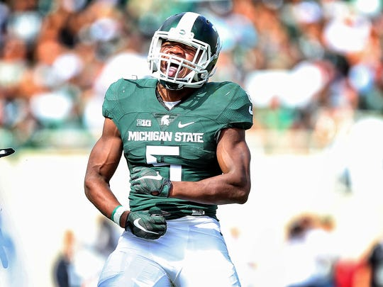 Michigan State linebacker Andrew Dowell celebrates