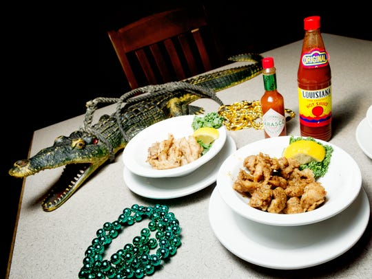 Grilled, blackened and deep fried gator are presented