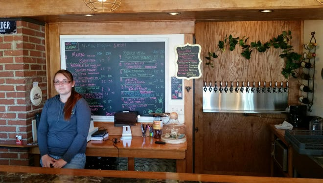 Julee Bender keeps an eye on the bar in the Tasting Room at Wolfgang's Thirst Parlor Tap House.