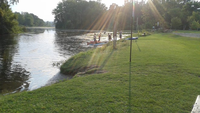 Milford Parks and Recreation wants to maintain the green space at the Huron River in Central Park. Canoeists and kayakers want to continue using it.