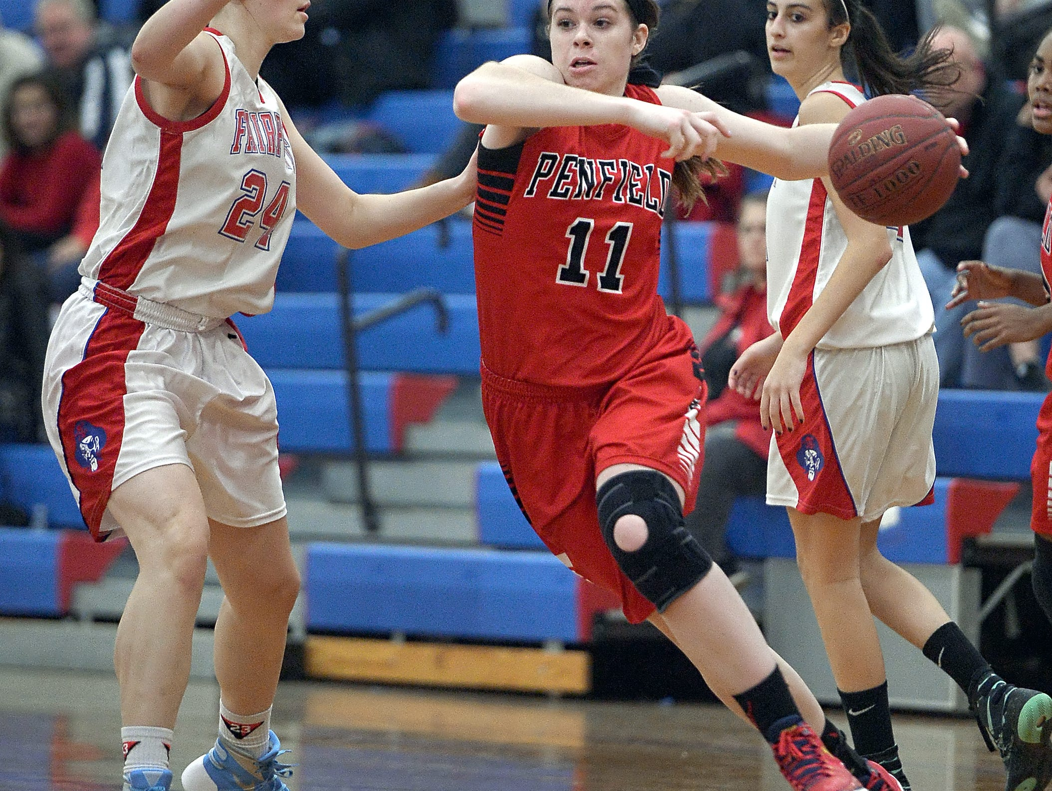 Penfield's Emma Guy, right, drives the baseline against Fairport's Hannah Ribble. Guy has committed to Boston College.