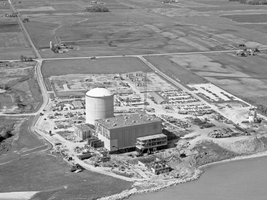 A photo shows the construction of the Kewaunee nuclear