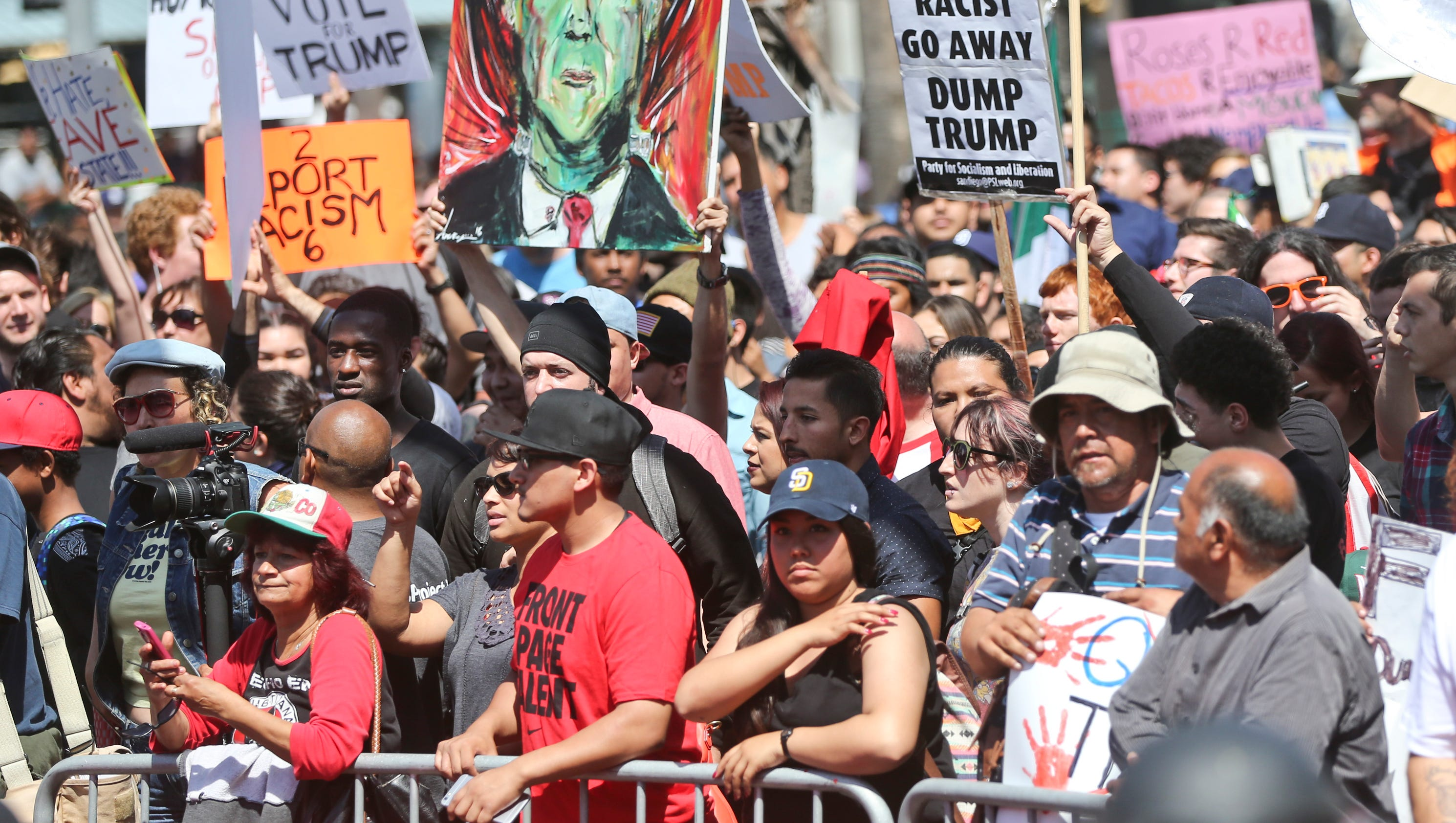 Protesters clash with supporters at San Diego Trump rally