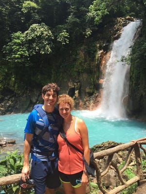 "Matthew and Elizabeth Kee stand in front of a waterfall overlooking the Rio Celeste (Sky Blue River) at Tenorio Volcano National Park in northern Costa Rica. The couple lived in the Central American country for about a year. They will be featured on an episode of ""House Hunters International"" on HGTV on Wednesday night."