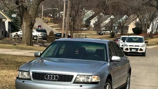 Witnesses reported an 18-year-old man became trapped underneath this car when he was trying to fix something underneath it in a driveway in the 7500 block of Southwest 15th Street on Tuesday afternoon.
