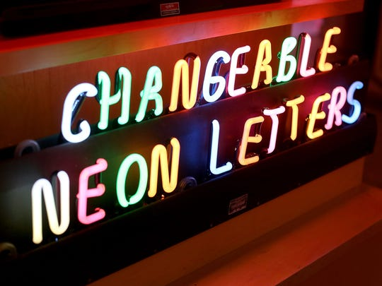 Placed amongst the large neon signs in the American