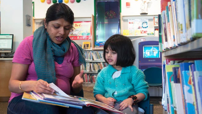 Radhika Singh reads to her daughter, Raagini Kalani, 3, at The Trove Children's Library in White Plains. Singh says she reads three or four books to her daughter every night.