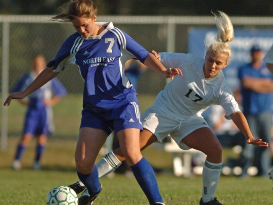 Parkside's Shelby Traum tries to get the ball away from a North East player during the first half of a soccer game.