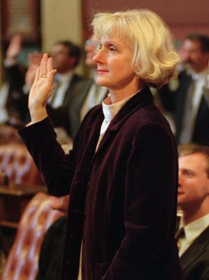 Patricia Birkholz takes the oath of office on the floor of the House of Representatives in Lansing in 1997.