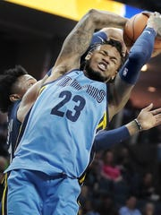 Memphis Grizzlies guard Ben McLemore (23) is fouled on a shot attempt against the Piston's during their NBA game Sunday April 8, 2018 at the FedExForum.