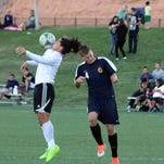 Ulises Flores, right, controls the ball during Wednesday's game against Boulder City.