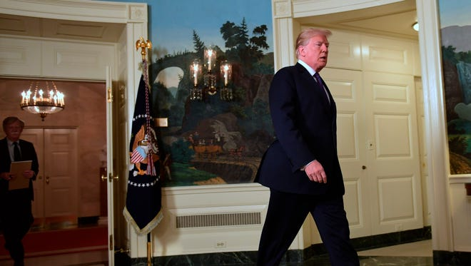 President Trump walks in to speak in the Diplomatic Reception Room of the White House Friday to speak to the nation about the U.S. military response to Syria's chemical weapon attack on April 7.