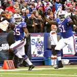 Bills Jerry Hughes (55) returns a fumble for an 18-yard touchdown after stripping Cleveland running back Terrence West of the ball as the Buffalo beat Cleveland 26-10.