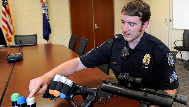 Sgt. Jonathan Thum talks about the latest in less-lethal alternatives to bullets Ñ Òblunt impact projectilesÓ at the Law Enforcement Center in Sioux Falls, SD; Tuesday, Aug. 25, 2015.