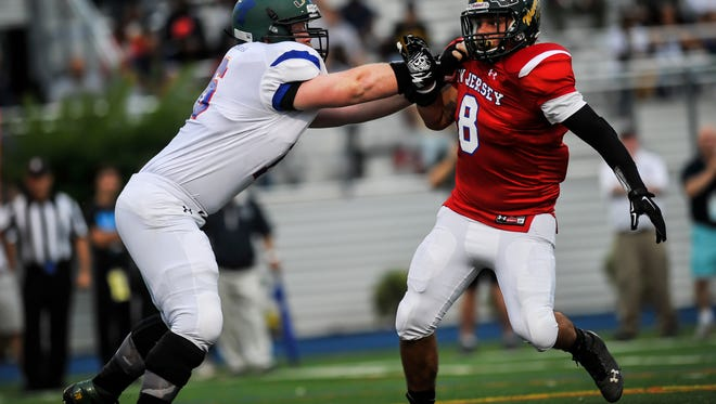 North Hunterdon's Sam Kowal blocks Long Branch's Brandon Lane during the North-South All-Star game at Kean University in Union on June 27, 2016.
