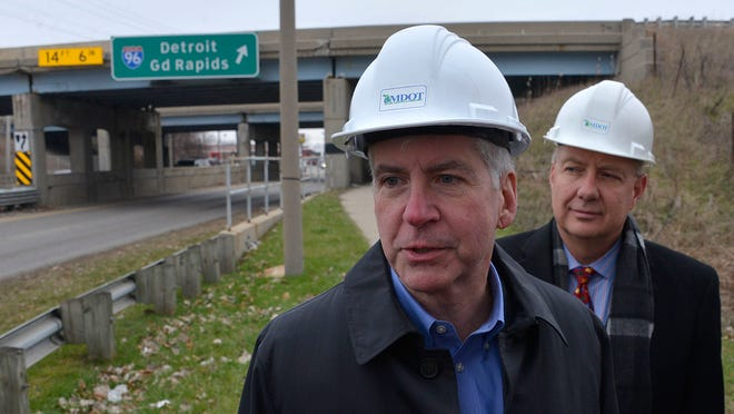 Michigan Governor Rick Snyder and roads chief Kirk Steudle inspect a bridge on I-96 at Cedar St. in Lansing on Friday to highlight the need for additional funding for road repair in the state.