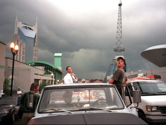 Motorists stop on Lower Broadway near the arena to watch a storm move through downtown Nashville on Thursday, April 16, 1998.